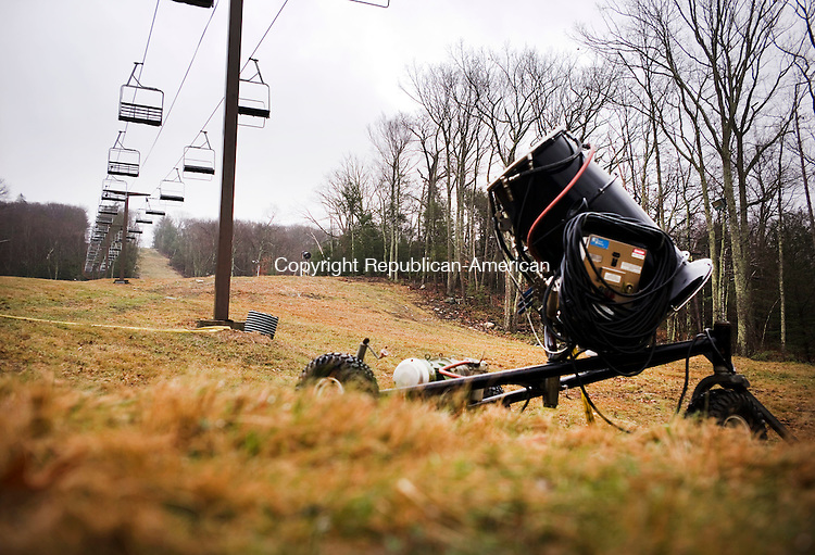 New Hartford, CT- 22 December 2015-122215CM02-  A snow gun is seen below chair lifts at Ski Sundown in New Hartford on Tuesday.   The ski area was temporarily closed as warm weather and lack of snow has prevented it from opening. Christopher Massa Republican-American