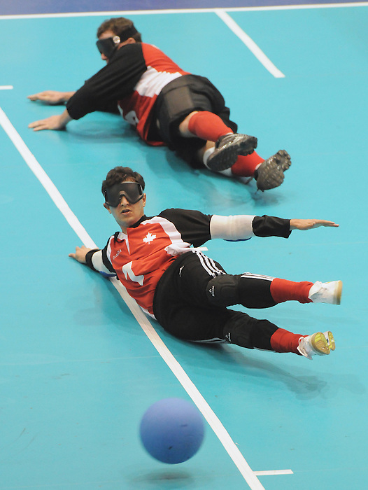 November 18 2011 - Guadalajara, Mexico:  Ahmad Zeividavi and Bruno Hache of Team Canada attempt to make a stop in the Goalball Bronze Medal Match in the San Rafael Park Sports Complex at the 2011 Parapan American Games in Guadalajara, Mexico.  Photos: Matthew Murnaghan/Canadian Paralympic Committee