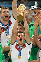 Julian Draxler of Germany lifts the World Cup trophy after winning the 2014 final