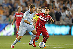 09 June 2011: Kansas City's Luke Sassano (32) and Chicago's Daniel Paladini (11). Sporting Kansas City played the Chicago Fire to a 0-0 tie in the inaugural game at LIVESTRONG Sporting Park in Kansas City, Kansas in a 2011 regular season Major League Soccer game.
