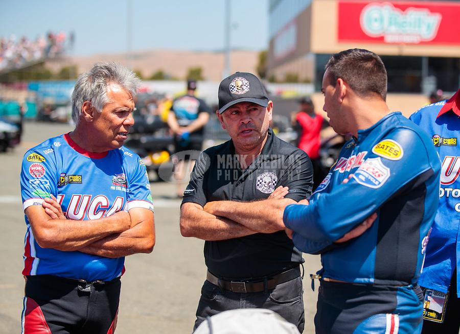 Jul 28, 2019; Sonoma, CA, USA; NHRA top fuel driver Mike Salinas (center) with pro stock motorcycle rider Hector Arana Sr (left) and Hector Arana Jr during the Sonoma Nationals at Sonoma Raceway. Mandatory Credit: Mark J. Rebilas-USA TODAY Sports