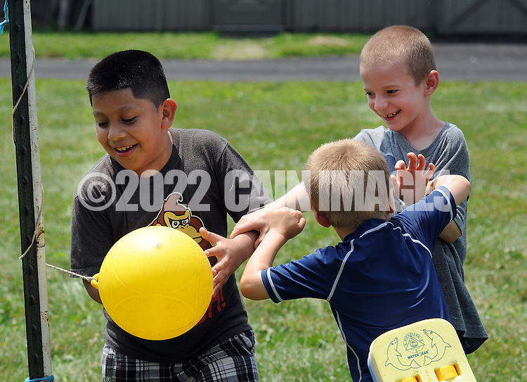 HILLTOWN, PA - JULY 12:  From left, Angel Lane, 8 of Bronx, New York, Shane Kelly, 5 and Nathan Kelly, 8 of Hatboro, Pennsylvania play during a Fresh Air Fund picnic at the home of former Fresh Air Fund child Nancy Ortiz and her husband, Dave Sharp July 12, 2014 in Hilltown, Pennsylvania. They have been holding a picnic in honor of the children for more than 30 years. (Photo by William Thomas Cain/Cain Images)