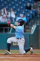 Kole Enright (12) of the Hickory Crawdads goes down to one knee as he follows through on his swing against the Ocelotes de Greensboro at First National Bank Field on June 11, 2019 in Greensboro, North Carolina. The Crawdads defeated the Ocelotes 2-1. (Brian Westerholt/Four Seam Images)