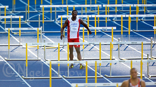 20 AUG 2009 - BERLIN, GER - Dayron Robles (CUB) limps from his Mens 110m Hurdles Semi Final at the World Athletics Championships .(PHOTO (C) NIGEL FARROW)