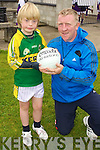 Liam Purcell gets the player of the week award from John Dillon  pictured at the GAA Summer camp at Austin Stacks Club, Connolly Park Tralee on Friday.