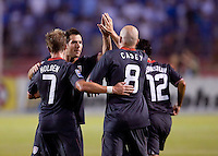 Conor Casey is congratulated after scoring one of two goals against Honduras. .USA clinches a spot in the  2010 World Cup after defeating Honduras in 3-1 during CONCACAF qualifying in San Pedro Sula, Honduras, October 10, 2009.