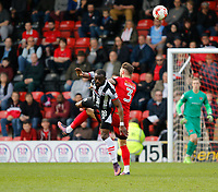 Grimsby Town's Tom Bolarinwa contests the ball with Leyton Orient's Callum Kennedy during the Sky Bet League 2 match between Leyton Orient and Grimsby Town at the Matchroom Stadium, London, England on 11 March 2017. Photo by Carlton Myrie / PRiME Media Images.
