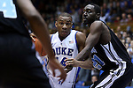 04 November 2014: Duke's Rasheed Sulaimon (14) is defended by Livingstone's Daresse Johnson (21). The Duke University Blue Devils hosted the Livingstone College Blue Bears at Cameron Indoor Stadium in Durham, North Carolina in an NCAA Men's Basketball exhibition game. Duke won the game 115-58.