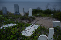 The Midgett Salvo graveyard is falling into the Pamlico Sound in Salvo, NC on Saturday, May 20, 2017. (Justin Cook/Blink for Lyra)
