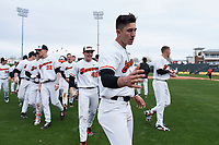 The Oregon State Beavers celebrate a victory against the New Mexico Lobos on February 15, 2019 at Surprise Stadium in Surprise, Arizona. Oregon State defeated New Mexico 6-5. (Zachary Lucy/Four Seam Images)
