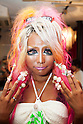 Ayuyun, a member of staff, shows off her nail art at the Ganguro Cafe &amp; Bar in the Shibuya shopping area on September 4, 2015. <br /> <br /> Ganguro is an alternative Japanese fashion trend which started in the mid-1990s where young women, rebelling against the traditional idea of Japanese beauty, wore colorful make-up and clothes and had dark-skin.<br /> <br /> 10 Ganguro fashion girls work in the new bar, which offers original Ganguro Balls (fried takoyaki style sausage balls in black squid ink batter) on its menu. Ganguro Caf&eacute; &amp; Bar also offers special services such as Ganguro make-up and the chance to take purikura (photo booth pictures) with staff and to look like a Ganguro girl walking around the Shibuya streets.<br /> <br /> The bar is popular with both Japanese and foreigners and has menus translated in English. (Photo by Rodrigo Reyes Marin/AFLO)