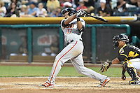 Chris Dominguez (17) of the Fresno Grizzlies at bat against the Salt Lake Bees at Smith's Ballpark on May 25, 2014 in Salt Lake City, Utah.  (Stephen Smith/Four Seam Images)
