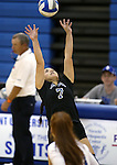 Marymount's Ashley Cabrera sets in a college volleyball game, in Arlington, Vir., on Saturday, Nov. 1, 2014.<br /> Photo by Cathleen Allison