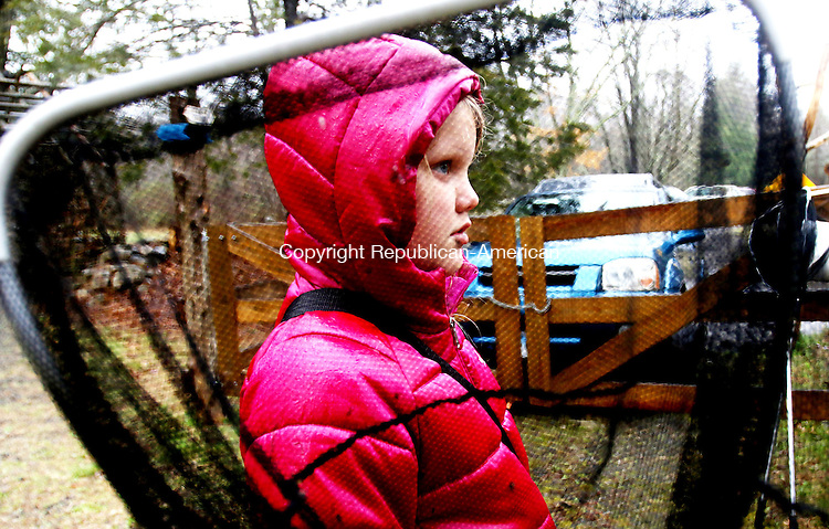 WOODBURY CT. 12 April 2016-041216SV04-Emma Parris, 8, of Southbury joins a group looking for creatures for a lesson during a spring break class at Flanders Nature Center in Woodbury Tuesday.<br /> Steven Valenti Republican-American