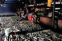 SIERRA LEONE fish smoking unit in Tombo, food security and the livelyhood of small fishermen are affected by international big trawler fleet / SIERRA LEONE Fischraeucherei im Fischerhafen Tombo, die Ernaehrungssicherung der Kuestenbewohner und die Existenz von Kuestenfischern ist durch Ueberfischung grosser Trawler Flotten bedroht