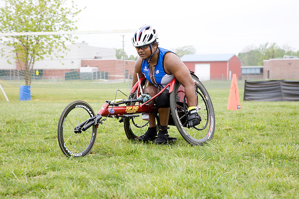 Minda races towards the finish line on her racing wheelchair during the running leg of the New Jersey Devilman Triathlon on May 5, 2012 in Cumberland County, New Jersey.