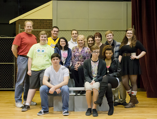 """Playwright Ellen Hopkins, center, poses with the cast during TheatreWork's rehearsal of """"Flirting With the Monster"""" taken on Sunday afternoon, January 5, 2014 at the Laxalt Auditorium."""