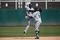 OAKLAND, CA - AUGUST 15:  Guillermo Heredia #5 and Dee Gordon #9 of the Seattle Mariners celebrate after the game against the Oakland Athletics at the Oakland Coliseum on Wednesday, August 15, 2018 in Oakland, California. (Photo by Brad Mangin)