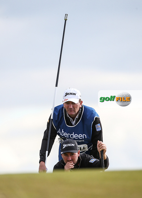 Graeme McDowell (NIR) &amp; caddie Ken Comboy look to birdie the 18th  during Round Two of the 2016 Aberdeen Asset Management Scottish Open, played at Castle Stuart Golf Club, Inverness, Scotland. 08/07/2016. Picture: David Lloyd | Golffile.<br /> <br /> All photos usage must carry mandatory copyright credit (&copy; Golffile | David Lloyd)