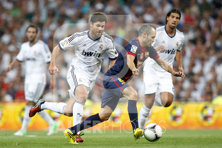 Real Madrid's Xabi Alonso and F.C. Barcelona's Andres Iniesta during Spanish Supercup 2nd match on august 29 2012...Photo: Cesar Cebolla / ALFAQUI
