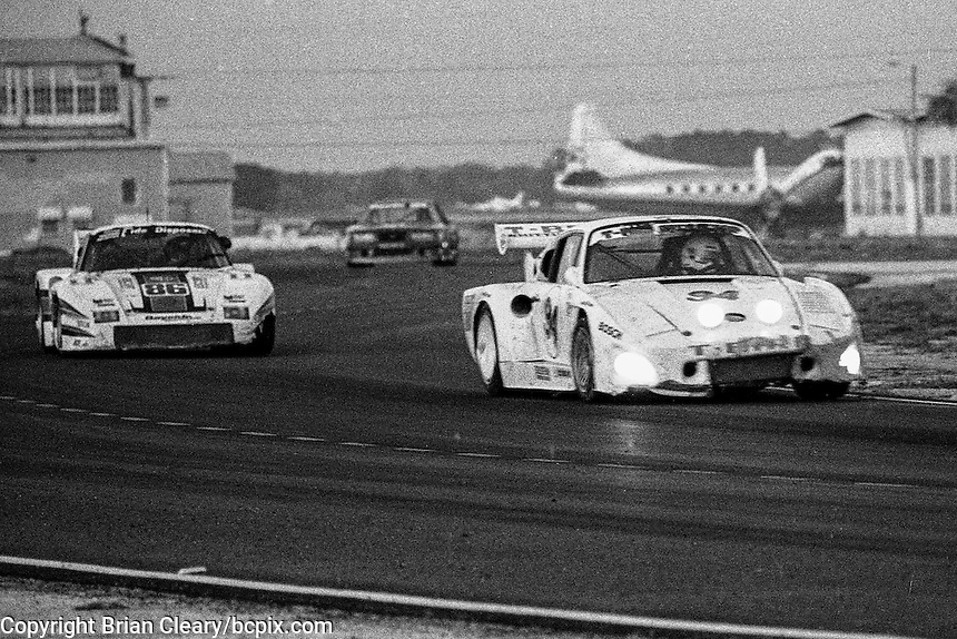 #94 Porsche 935 of Don Whittington and Bill Whittington (12th place) and #86 Porsche 935 of Bruce Leven,  Al Holbert, and Hurley Haywood (3rd place), 12 Hours or Sebring, Sebring International Raceway, Sebring, FL, March 19, 1983.  (Photo by Brian Cleary/bcpix.com)