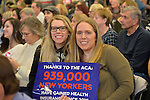 "Westbury, New York, USA. January 15, 2017.  L-R, sisters LAUREN GRAB and SUE MOLLER, both from Long Island, hold sign ""Thanks to the ACA 939,000 NEW YORKERS have gained health Insurance since 2010""  at the ""Our First Stand"" Rally against Republicans repealing the Affordable Care Act, ACA, taking millions of people off health insurance, making massive cuts to Medicaid, and defunding Planned Parenthood. Hosts were Reps. K. Rice (Democrat - 4th Congressional District) and T. Suozzi (Dem. - 3rd Congress. Dist.). It was one of dozens of Bernie Sanders' rallies for health care nationwide that Sunday."