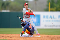 St. Louis Cardinals shortstop Pete Kozma #38 throws to first as Jimmy Paredes #38 slides in during a Spring Training game against the Houston Astros at Osceola County Stadium on March 1, 2013 in Kissimmee, Florida.  The game ended in a tie at 8-8.  (Mike Janes/Four Seam Images)