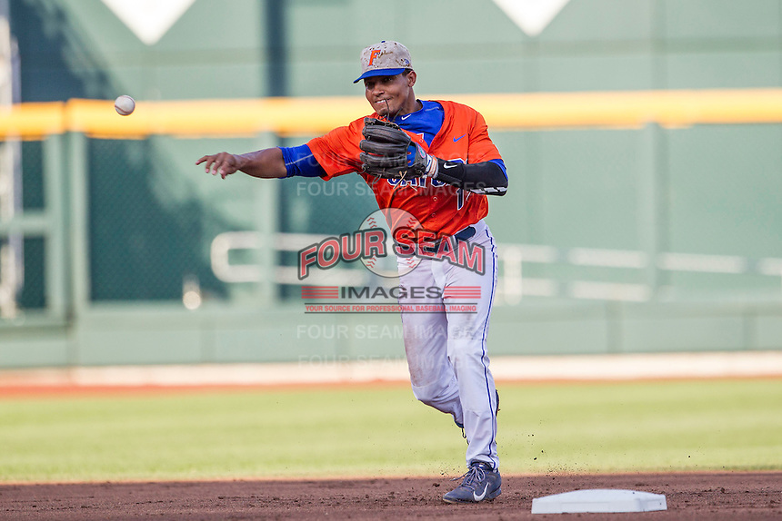 Florida Gators shortstop Richie Martin (12) makes a throw to first base against the Virginia Cavaliers in Game 13 of the NCAA College World Series on June 20, 2015 at TD Ameritrade Park in Omaha, Nebraska. The Cavaliers beat the Gators 5-4. (Andrew Woolley/Four Seam Images)