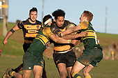 Rupeni Unga has his run stopped by Jamie Orr and Taine McQuoid. Counties Manukau Premier Club Rugby game between Bombay and Pukekohe, played at Bombay on Saturday June 30th 2018.<br /> Bombay won the game 24 - 14 after leading 24 - 0 at halftime.<br /> Bombay 24 - Sepuloni Taufa, Tulele Masoe, Chay Mackwood, Liam Daniela tries, Ki Anufe 2 conversions.<br /> Pukekohe Mitre 10 Mega 14 - Joshua Baverstock, Gregor Christie tries; Cody White 2 conversions.<br /> Photo by Richard Spranger.