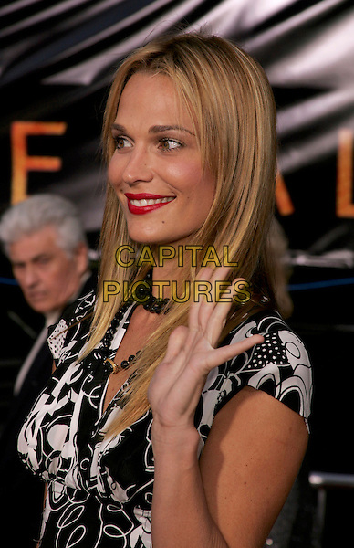 "MOLLY SIMMS.The Los Angeles Premiere of ""Collateral"" held at The historic Orpheum Theatre in Downtown Los Angeles, California .August 2,2004.headshot, portrait, waving, gesture.www.capitalpictures.com.sales@capitalpictures.com.Supplied By Capital Pictures"