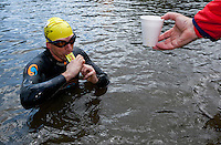 10 JUN 2011 - BRANSGORE, GBR - Triple Enduroman competitor Matt Fisher stops for an energy gel during the Enduroman Ultra Triathlon Championships (PHOTO (C) NIGEL FARROW)