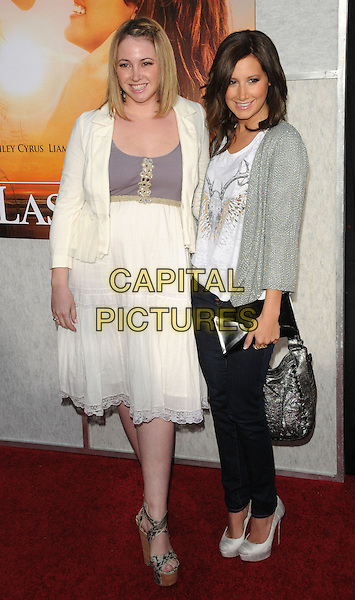 "JENNIFER & ASHLEY TISDALE .at the Touchstone Pictures' World Premiere of ""The Last Song"" held at The Arclight  in Hollywood, California, USA, March 25th 2010.           .arrivals Full length family sisters dress cream jeans silk satin platform shoes christian louboutin jacket cardigan dress wedges bag white sparkly knit knitted  top t-shirt silver grey gray                                     .CAP/RKE/DVS.©DVS/RockinExposures/Capital Pictures"