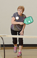 NWA Democrat-Gazette/BEN GOFF @NWABENGOFF<br /> Judy Tobler of Rogers returns the ball on Monday Nov. 16, 2015 during a game of pickleball at the City of Rogers Senior Wellness Center.