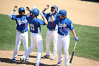 Zach McKinstry (24), T.J. Peters (31), and  Yusniel Diaz (21) of the Rancho Cucamonga Quakes welcome teammate Luke Raley (15) at home plate after hitting a home run during a game against the Stockton Ports at LoanMart Field on May 28, 2017 in Rancho Cucamonga, California. Stockton defeated Rancho Cucamonga, 7-4. (Larry Goren/Four Seam Images)