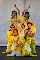 Girls wearing yellow outfits dancing traditional Chinese Dance, Northwest Folklife Festival 2016, Seattle Center, Washington, USA.