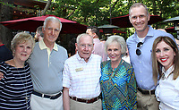NWA Democrat-Gazette/CARIN SCHOPPMEYER  (from left), Ed and Carol Clifford and Ben McLintock and Kelly Kemp-McClintock gather at The Jones Center Wine Walk on May 30 at Sassafras Springs Vineyard and Winery in Springdale.