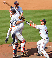 Tyler Wilson #18, John Hicks #8, Steven Proscia #19 and Jared King #13 celebrate as the Virginia Cavaliers defeated the Florida State Seminoles 7-2 to win the Championship Game of the 2011 ACC Baseball Tournament at the Durham Bulls Athletic Park on May 29, 2011 in Durham, North Carolina.  Photo by Brian Westerholt / Four Seam Images