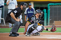 John Hester (22) of the Salt Lake Bees and home plate umpire Ryan Goodman during the game against the Tacoma Rainiers in Pacific Coast League action at Smith's Ballpark on July 8, 2014 in Salt Lake City, Utah.  (Stephen Smith/Four Seam Images)