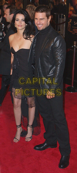 PENELOPE CRUZ & TOM CRUISE.attend the Warner Brother's The Last Samurai U.S. Premiere held at The Mann Village Theater in Westwood . .01/12/2003.full length, full-length, black leather jacket, trousers, little black strapless dress, strappy shoes, sandals.www.capitalpictures.com.sales@capitalpictures.com.©Capital Pictures.