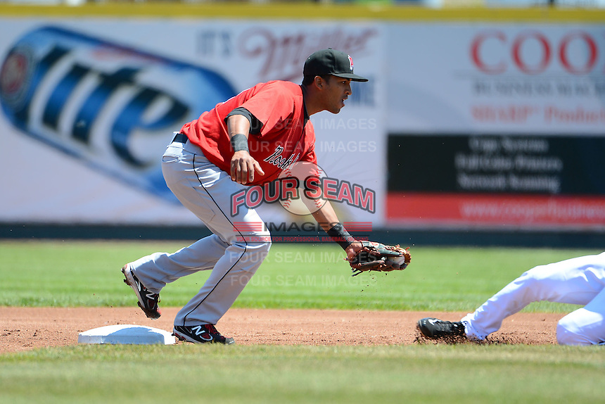 New Britain Rock Cats second baseman Eddie Rosario #13 tags out Eugenio Suarez #12 attempting to steal during a game against the Erie Seawolves on June 20, 2013 at Jerry Uht Park in Erie, Pennsylvania.  New Britain defeated Erie 2-0.  (Mike Janes/Four Seam Images)