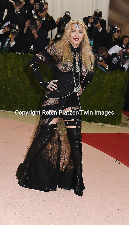 Madonna attends the Metropolitan Museum of Art Costume Institute Benefit Gala on May 2, 2016 in New York, New York, USA. The show is Manus x Machina: Fashion in an Age of Technology. <br /> <br /> photo by Robin Platzer/Twin Images<br />  <br /> phone number 212-935-0770