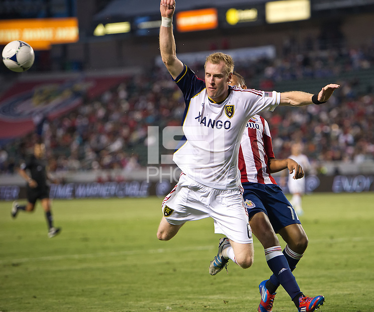 CARSON, CA - June 16, 2012: Real Salt Lake midfielder Nat Borchers (6) during the Chivas USA vs Real Salt Lake match at the Home Depot Center in Carson, California. Final score Real Salt Lake 3, Chivas USA 0.