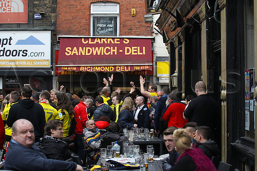 14.04.2016. Liverpool, England.  Borussia Dortmund and Liverpool fans enjoy a pre-match pint together at one of the may pubs in Liverpool city centre while they wait for tonight's UEFA Europa League quarter finals  match between Liverpool FC and Borussia Dortmund at the Anfield stadium in Liverpool, north west Britain 14 April 2016.