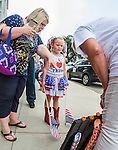 MOBILE, AL- AUGUST 21: Annie Lamb (L) and her 6 year-old daughter Laci , of Lucedale, MS, pick out a Donald Trump campaign button as they wait in line prior to a Donald Trump campaign rally outside Ladd-Peebles Stadium on August 21, 2015 in Mobile, Alabama. The Donald Trump campaign moved tonight's rally to a larger stadium to accommodate demand. (Photo by Mark Wallheiser/Getty Images)
