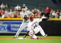Apr. 11, 2011; Phoenix, AZ, USA; St. Louis Cardinals second baseman Skip Schumaker forces out Arizona Diamondbacks base runner (46) Juan Miranda as he throws to first to complete the double play in the fourth inning at Chase Field. Mandatory Credit: Mark J. Rebilas-