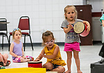 Prospect, CT. 17 July 2019-071719 - From left, Ava Wilson, 2, of Cheshire looks on as, Emma Odza, 3, of Prospect, and Amelia Williams, 3, of Wolcott play their drums, during a interactive presentation by Bob Bloom hosted by the Friends of the Prospect Library, at the Prospect Fire House in Prospect on Wednesday. Bill Shettle Republican-American