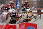 DEADWOOD, SD - FEBRUARY 1, 2013:  Racers in a Pro Lite heat race barrell down the course  at the the ISOC Amsoil Deadwood Snocross event Friday at the Days of 76 Rodeo Grounds in Deadwood, S.D.   (Photo by Richard Carlson/dakotapress.org)