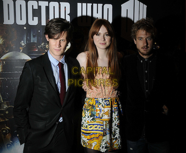 Matt Smith, Karen Gillan & Arthur Darvill.'Doctor Who: Asylum of the Daleks'  TV Preview and Q&A held at the BFI Southbank London, England..14th August 2012.Dr. Who half length black suit blue shirt pink gold orange top skirt pattern print jeans denim jacket yellow white beard facial hair  floral print.CAP/CAN.©Can Nguyen/Capital Pictures.