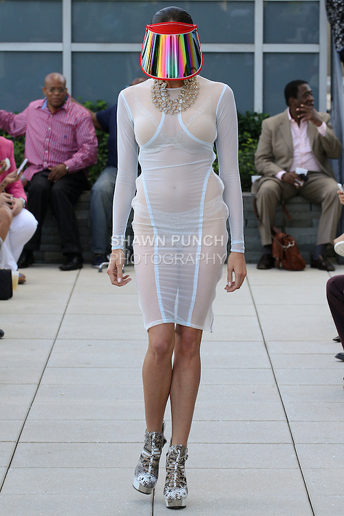 "Model walks runway in an outfit from the Edwing D'Angelo Resort 2015 ""Pedigree of the New Blue Blood Lineage"" collection, at 111 Central Park North on June 5, 2014."