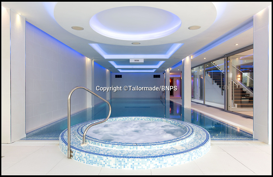 BNPS.co.uk (01202) 558833<br /> Pic: Tailormade/BNPS<br /> <br /> Poole and jacuzzi...<br /> <br /> This state of the art mega-home is for sale on the exclusive millionaires playground of Sandbanks in Poole, Dorset.<br /> <br /> The biggest, most expensive, and luxurious home ever to come on the market on the tiny peninsula, it is now selling for a cool £8.75m.<br /> <br /> Called The Moorings, the harbour front mansion has stunning sea views, and is on one of the most enviable plots on Millionaire's Row.<br /> <br /> Its owners, entrepreneur Chris Thomas and wife Sue, spent a staggering £5.5m building the palatial home that has been compared to a five star hotel.<br /> <br /> Spread over 13,000 sq ft - the equivalent size of seven detached houses - the state-of-the art property comes with five en suite bedrooms, three reception rooms, an office, cinema room, indoor swimming pool, sauna, gym, gate house and boat house.